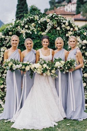 wedding colors 2019 bride and bridesmaids in grey dresses with white and greenery wedding bouquets katiegrantphoto