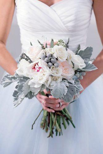 wedding colors 2019 grey leaves and white blush roses in bridal bouquet jamie reinhart photography