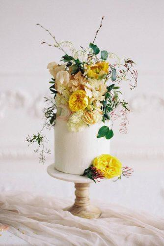 wedding colors 2019 small white cake with mustard flowers kateignatowskiphoto