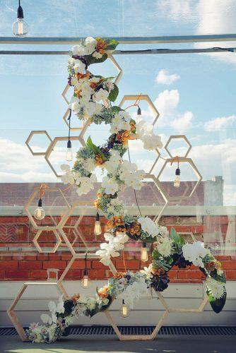 wedding decor 2019 geometric wooden backdop with light bulbs and white orchids flowers hikari