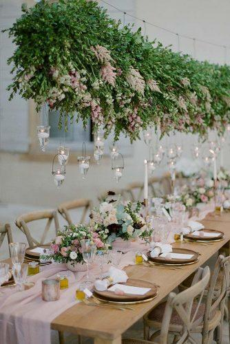 wedding decor 2019 hanging bold greenery with flowers and candles above the table gregfinck