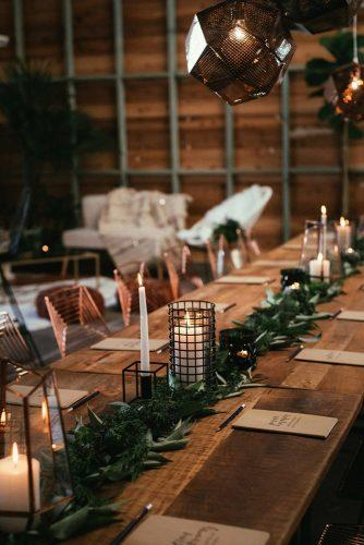 wedding decor 2019 industrial reception with candles and greenery tablerunner cj williams photography