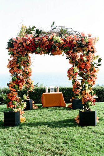 wedding decor 2019 orange roses and green leaves altar yvette roman photography