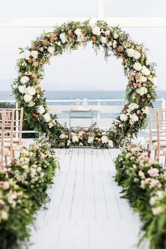 wedding decor 2019 outdoor ceremony with greenery aisle and altar with black flowers artographerwedding