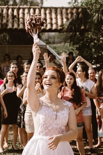 wedding music bride throwing bouquet in front of guests
