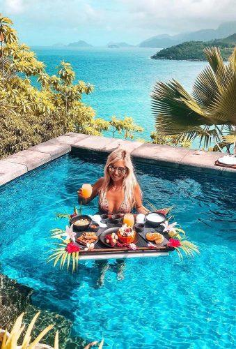 best honeymoon destinations breakfast in pool girl miss.everywhere