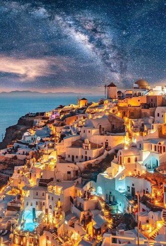 best honeymoon destinations evening lighting santorini greece wu_greece