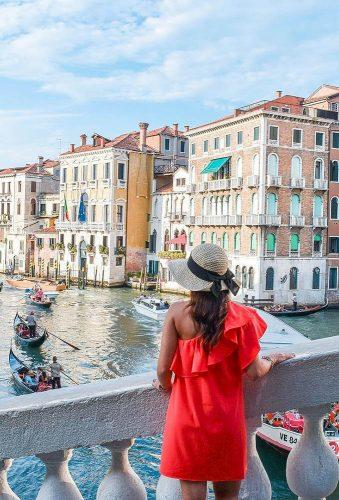 best honeymoon destinations girl in red dress venice andreastravelss