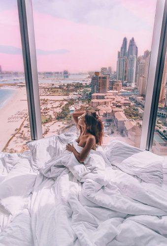 best honeymoon destinations girl near window rixospremiumdubai