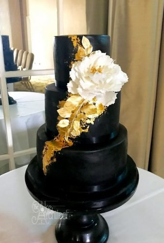 black wedding cake cake with gold and white flower cake architect
