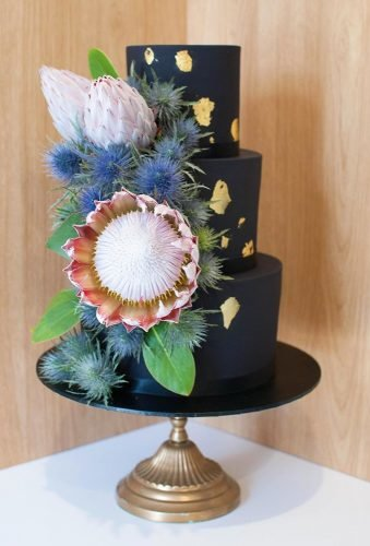 black wedding cake rustic cake with protea gooseberrycakeco