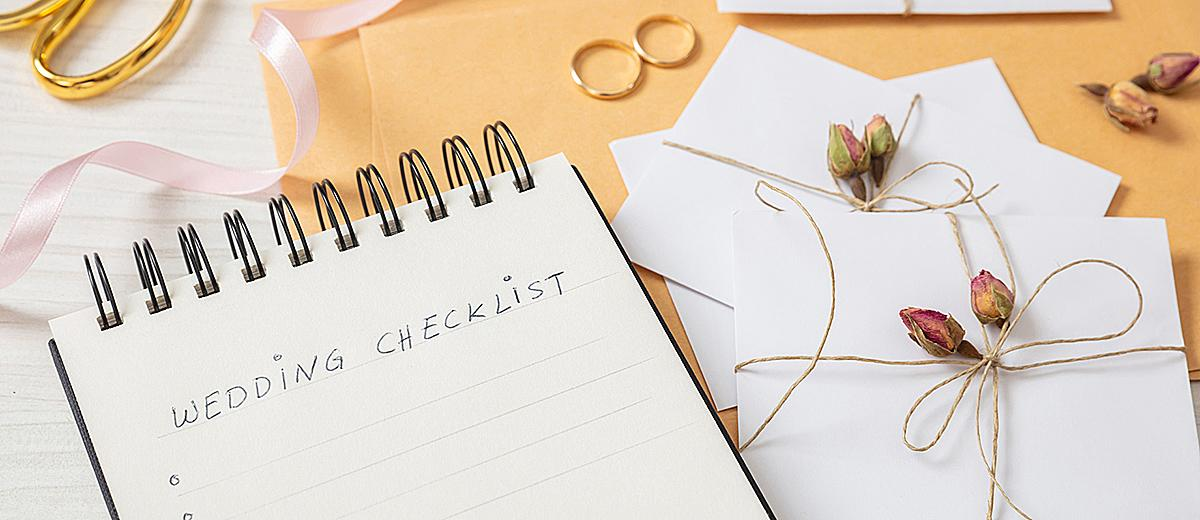 how to save money on a wedding planning book notes featured