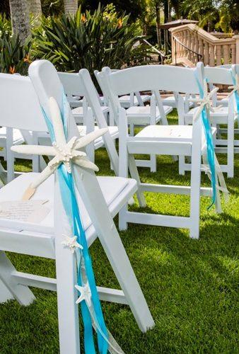 nautical wedding decor ideas starfish in chair decor SeashellCollection