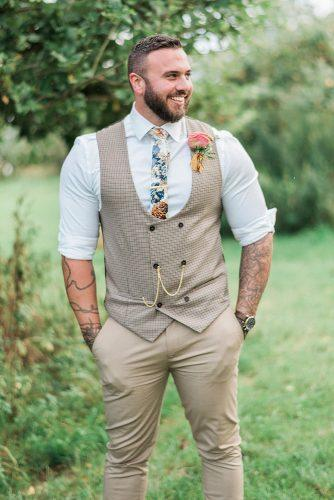 rustic groom attire western vest with boutonnieres and tie kathryn hopkins photography