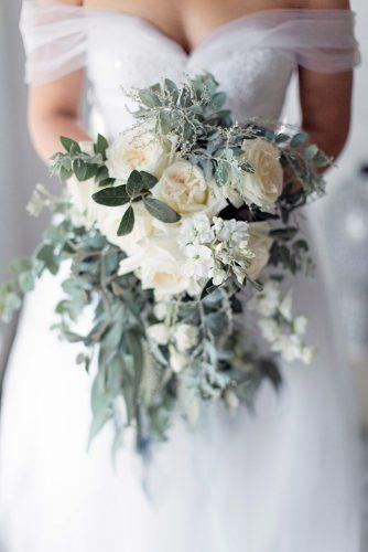silver sage wedding bouquet with white roses and cascading greenery clareece smit photography