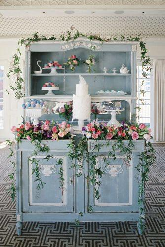 silver sage wedding buffet decorated with bright roses and greenery white modern cake ameliajohnsonphoto