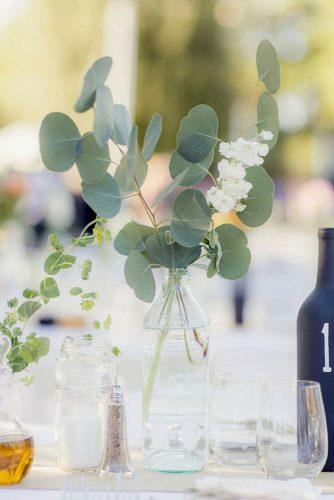 silver sage wedding eucalyptus leaves in glass bottle centerpiece figlewicz photography