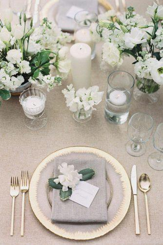 silver sage wedding grey and gold place setting with white flowers on the table lucy cuneo photography