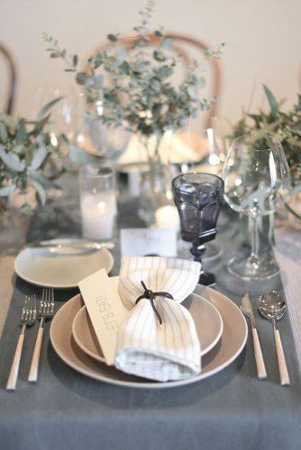 silver sage wedding place setting with greenery and eclectic glasses elizabeth messina photography
