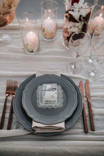 silver sage wedding place setting with grey and bronze dishes flowers and candles on table lighthouse photography