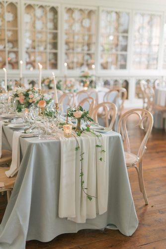 silver sage wedding reception tablecloth with greenery candles and roses emma pilkington photography