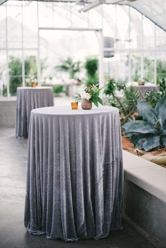 silver sage wedding round tall table with velvet grey tablecloth emily ann hughes photography