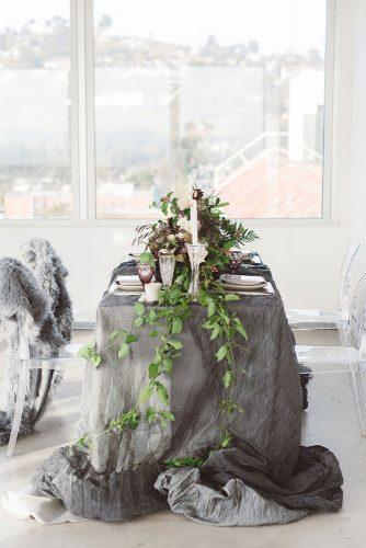 silver sage wedding tablecloth and greenery on bridal table anna delores photography