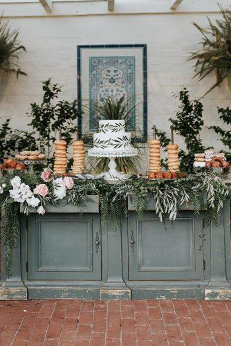 silver sage wedding wooden buffet decorated with blush roses and greenery white michellelillywhite