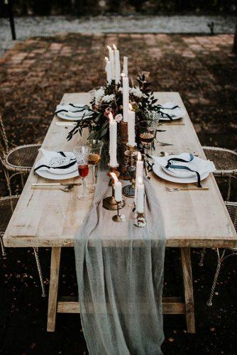 silver sage wedding wooden outdoor table with candles and greenery centerpiece yeray cruz