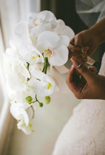 single stem wedding bouquets wedding orchid kirsten goslett photography