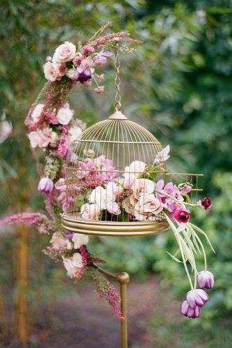 spring wedding décor hanging cage gold with roses tulips flowers and greenery the ganeys