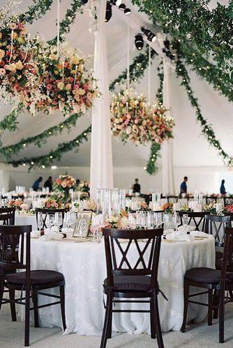 spring wedding decor reception under white tent with greenery and bright hanging flowers tecpetaja