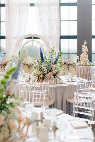 spring wedding décor reception with white tablecloth and flower centerpieces beigeweddings