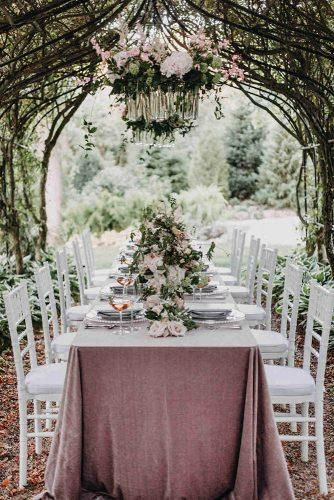 spring wedding decor bridal table with roses under branches tent outdoor lisa kathan photography