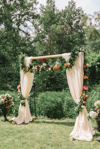 spring wedding decor garden ceremony arch with cream cloth and greenery flower garland oak & myrrh photography