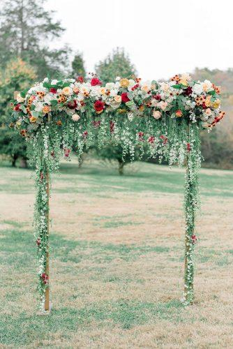 spring wedding decor garden ceremony arch with greenery and hanging flowers julie paisley associates