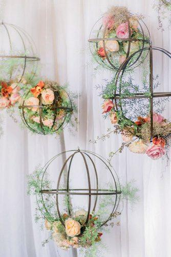spring wedding decor hanging cages with pink peach roses and greenery manda weaver photography