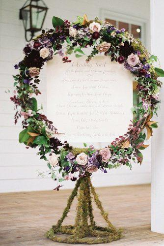spring wedding decor lilac roses flowers and moss signboard lauren kinsey