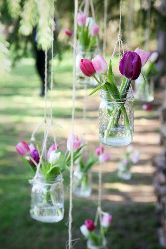 spring wedding decor pink lilac tulip in hanging glass jar lisa berry