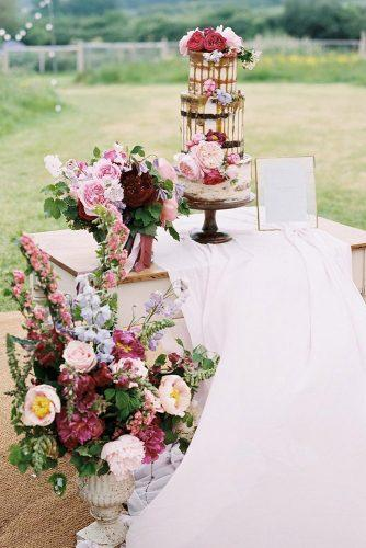 spring wedding decor vintage stand with bright flowers and drip cake baxterandted