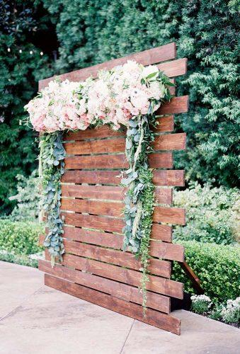 wedding backdrop ideas palete with flowers Sposto Photography