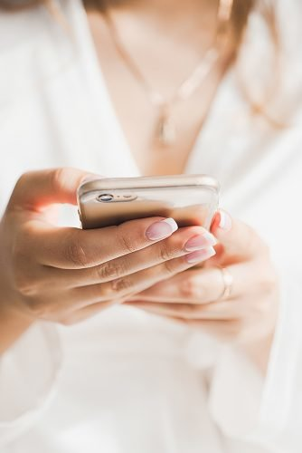 wedding checklist bride with phone planning