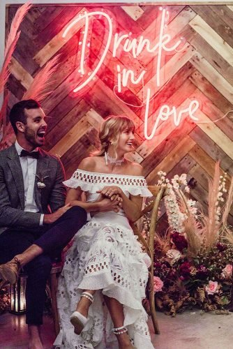 wedding trends 2019 bohemian wooden backdrop with neon romantic sign lilly red