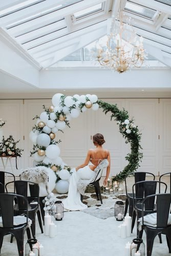 wedding trends 2019 round shaped arch with greenery and balloons olegs samsonovs photography
