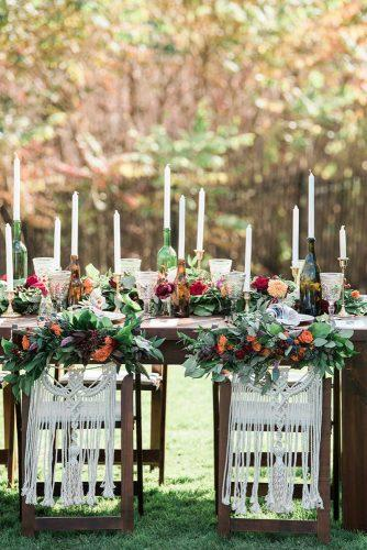 bohemian wedding decorations boho table with flowers candles in bottles and macrame on chairs the right moments photography