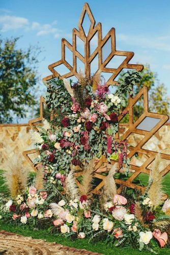 bohemian wedding decorations geometry wooden backdrop with pampas grass and burgundy roses jasonmizephoto