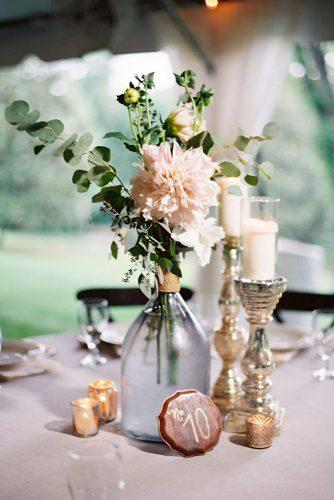 bohemian wedding decorations glass bottle with pink dahlias and greenery wooden tablenumber landonjacob