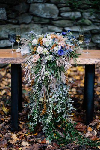 bohemian wedding decorations moody greenery and colorful wildflowers tablerunner hope helmuth