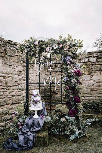 bohemian wedding decorations old window frame with neon signs flowers and boho bridal cake oobaloosphotography