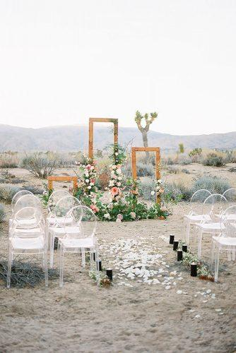 bohemian wedding decorations outdoor ceremony with flowers and greenery acrylic chairs heather anderson photo